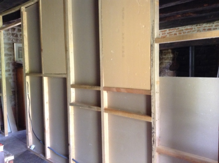 Insulating a stud partition wall