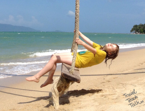 Katie swinging on the beach